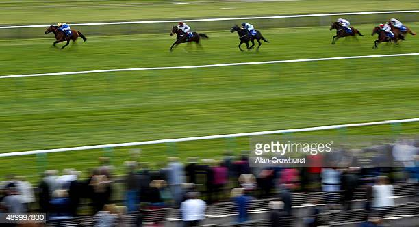 Ryan Moore riding Cannock Chase win The Sakhee Godolphin Stakes at Newmarket racecourse on September 25 2015 in Newmarket England
