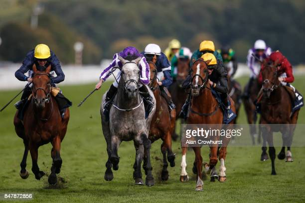 Ryan Moore riding Capri win The William Hill St Leger Stakes from Crystal Ocean and Stradivarius at Doncaster racecourse on September 16 2017 in...