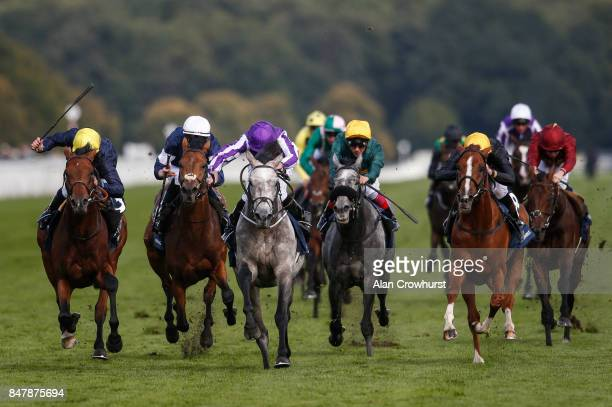 Ryan Moore riding Capri win The William Hill St Leger Stakes from Crystal Ocean and Stradivarius at Doncaster racecourse on September 16, 2017 in...