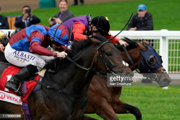 Ryan Moore riding Caravan Of Hope win The Veolia Novice Stakes at Ascot Racecourse on October 04, 2019 in Ascot, England.