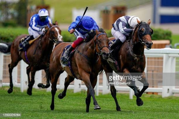 Ryan Moore riding Circus Maximus win The Queen Anne Stakes from Frankie Dettori and Terebellum at Ascot Racecourse on Day 1 of the Royal Meeting on...