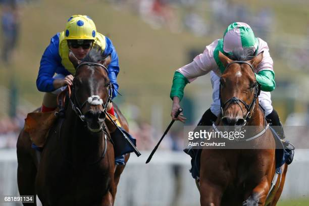Ryan Moore riding Deauville win The sportingbetcom Huxley Stakes from Poet's Word at Chester Racecourse on May 11 2017 in Chester England