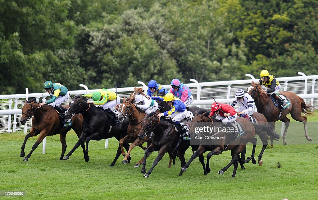 Ryan Moore riding Garswood (R, red) win Thebet365 Lennox Stakes at Goodwood racecourse on July 30, 2013 in Chichester, England.