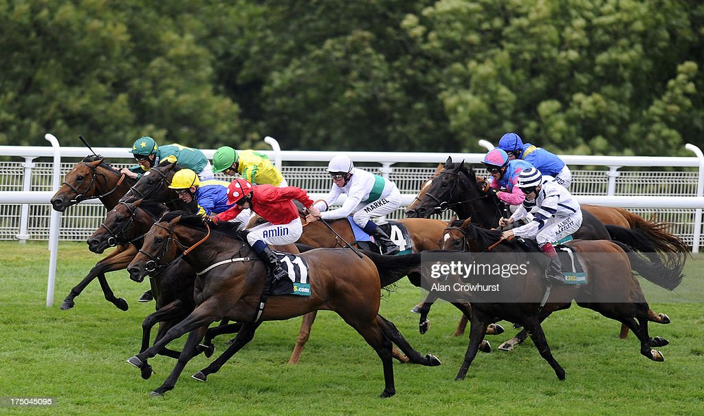 Ryan Moore riding Garswood (red) win Thebet365 Lennox Stakes at Goodwood racecourse on July 30, 2013 in Chichester, England.