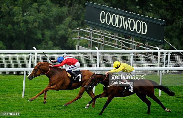 Ryan Moore riding Gospel Choir win The Santa MAria Foodservice Stakes at Goodwood racecourse on September 25 2013 in Chichester England