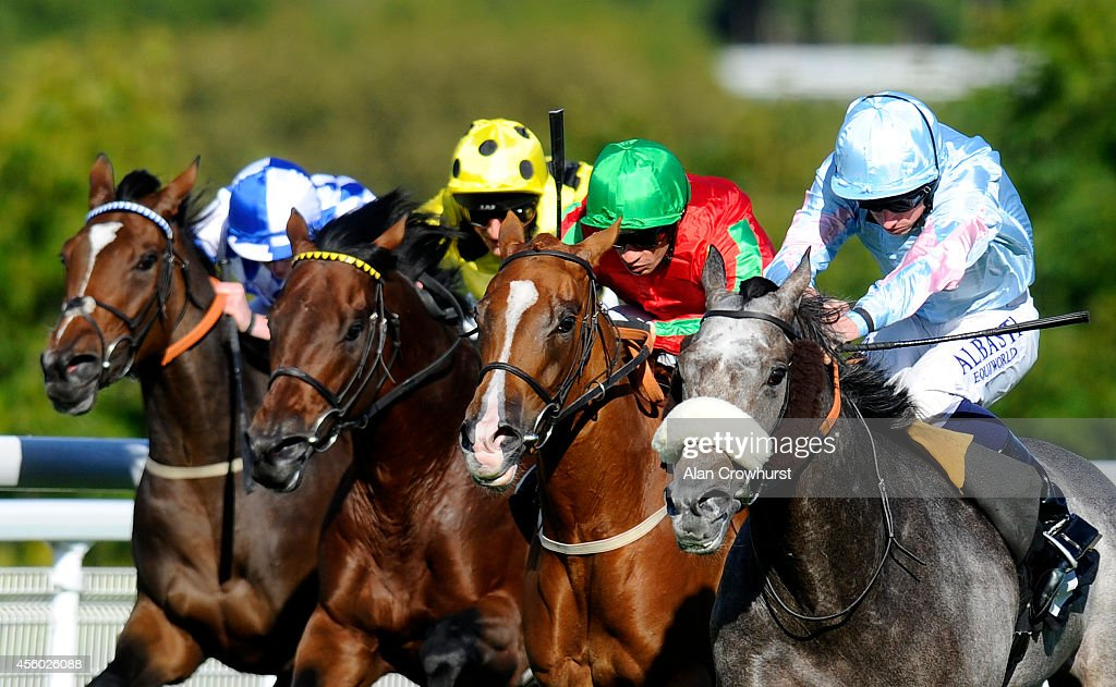 Ryan Moore riding Grandeur (R) win The R H Hall Foundation Stakes at Goodwood racecourse on September 24, 2014 in Chichester, England.