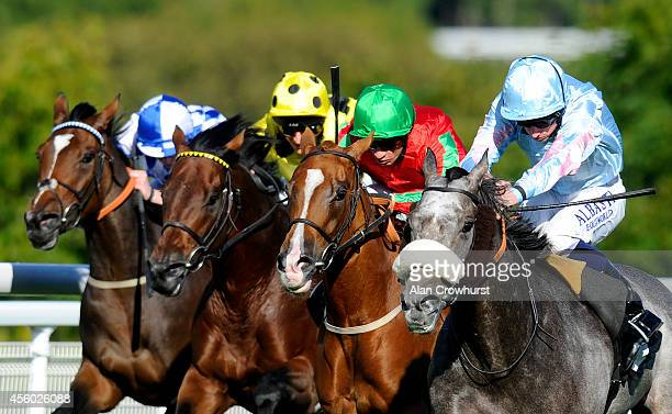 Ryan Moore riding Grandeur win The R H Hall Foundation Stakes at Goodwood racecourse on September 24 2014 in Chichester England