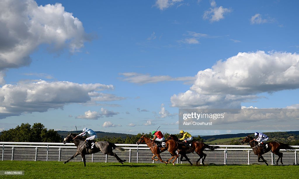 Ryan Moore riding Grandeur (L) win The R H Hall Foundation Stakes at Goodwood racecourse on September 24, 2014 in Chichester, England.