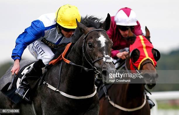 Ryan Moore riding Graphite Storm win The Dubai Duty Free Nursery Handicap Stakes at Newbury Racecourse on September 17 2016 in Newbury England