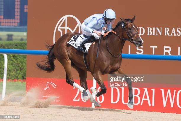 Ryan Moore riding Heavy Metal wins the Godolphin Mile during the Dubai World Cup Day at Meydan Racecourse on March 31 2018 in Dubai United Arab...
