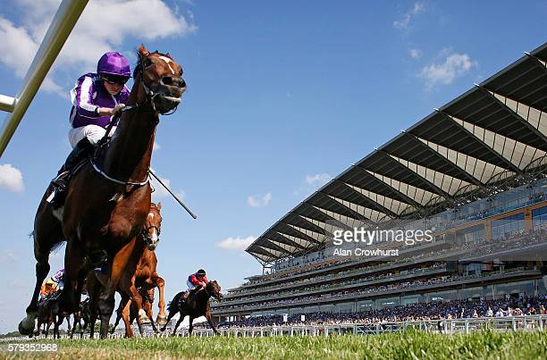 Ryan Moore riding Highland Reel win The King George VI And Queen Elizabeth Stakes at Ascot Racecourse on July 23 2016 in Ascot England