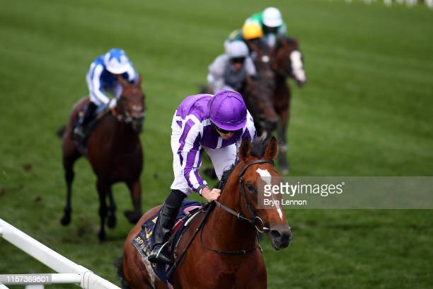 Ryan Moore riding Japan in action on his way to winning The Commonwealth Cup on day four of Royal Ascot at Ascot Racecourse on June 21, 2019 in...