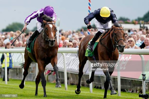 Ryan Moore riding Japan win The Juddmonte International Stakes from Crystal Ocean and James Doyle at York Racecourse on August 21, 2019 in York,...