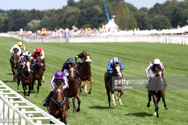 Ryan Moore riding Kew Gardens leads the Queens Vase on day 2 of Royal Ascot at Ascot Racecourse on June 20 2018 in Ascot England