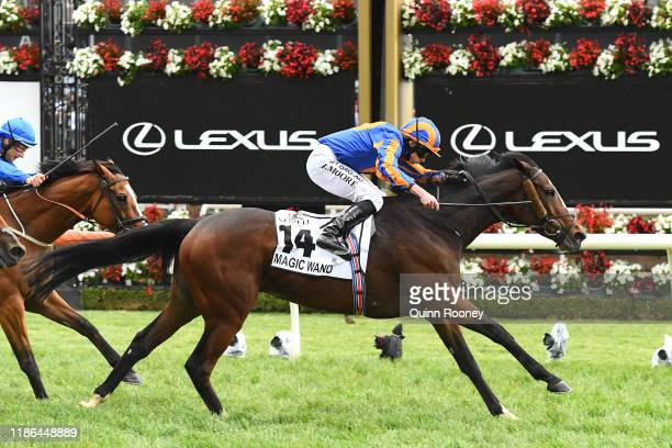 Ryan Moore riding Magic Wand wins the Seppelt Mackinnon Stakes during 2019 Stakes Day at Flemington Racecourse on November 09 2019 in Melbourne...