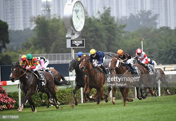 Ryan Moore riding Maurice from Japan wins as Joao Moreira riding Able Friend flashes home for 3rd in Race 7 The Longines Hong Kong Mile during the...