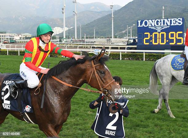 Ryan Moore riding Maurice of Japan after winning Race 8 the Longines Hong Kong Cup during Hong Kong International Racing at Sha Tin Racecourse on...