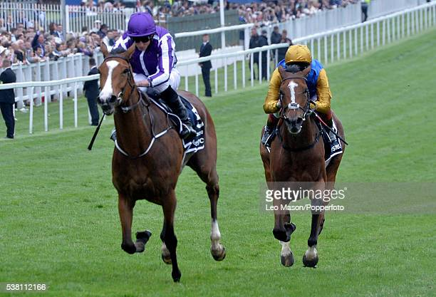 Ryan Moore riding Minding win The Invstec Oaks from Architecture and Frankie Dettori at Epsom Racecourseon Investec Ladies Day on June 3 2016 in...