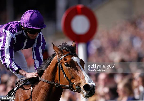 Ryan Moore riding Minding win The Qipco 1000 Guineas Stakes at Newmarket racecourse on May 1 2016 in Newmarket England
