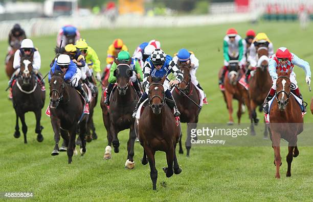 Ryan Moore riding Protectionist crosses the line to win the Emirates Melbourne Cup on Melbourne Cup Day at Flemington Racecourse on November 4 2014...