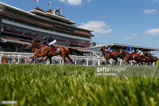 Ryan Moore riding Rhododendron win The Al Shaqab Lockinge Stakes from Lightning Spear at Newbury Racecourse on May 19 2018 in Newbury United Kingdom