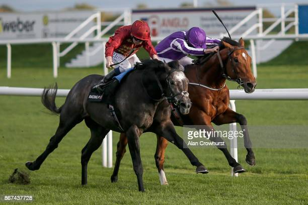 Ryan Moore riding Saxon Warrior win The Racing Post Trophy Stakes from Roaring Lion at Doncaster racecourse on October 28 2017 in Doncaster United...
