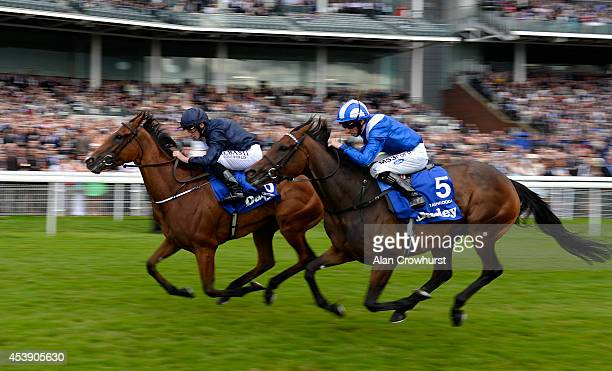 Ryan Moore riding Tapestry win The Darley Yorkshire Oaks from Taghrooda at York racecourse on August 21 2014 in York England