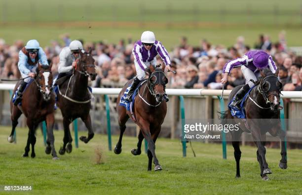 Ryan Moore riding US Navy Flag win The Darley Dewhurst Stakes at Newmarket racecourse on October 14 2017 in Newmarket United Kingdom