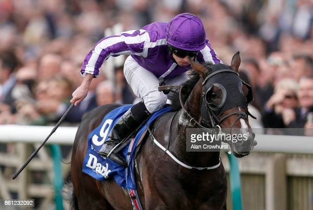 Ryan Moore riding US Navy Flag wins The Darley Dewhurst Stakes at Newmarket racecourse on October 14 2017 in Newmarket United Kingdom