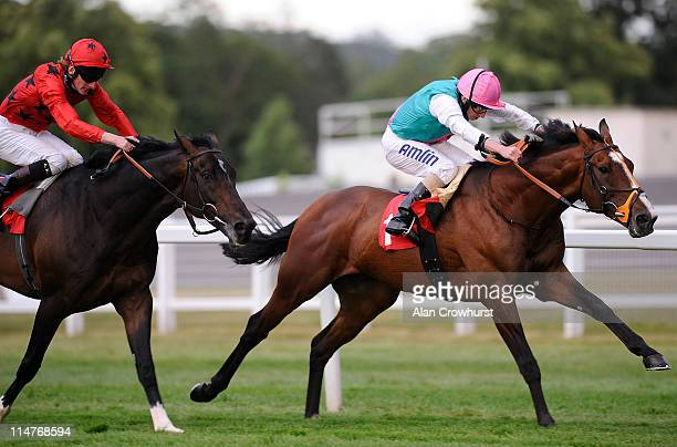 Ryan Moore riding Workforce win The Piper Heidsieck Champagne Brigadier Gerard Stakes from Poet and Adam Kirby at Sandown racecourse on May 26, 2011...