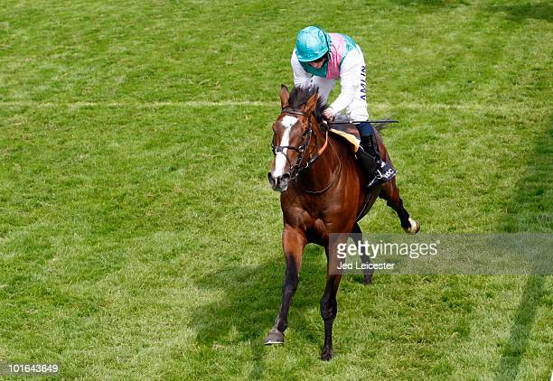Ryan Moore riding Workforce wins the Investec Derby during the Investec Derby Festival at Epsom racecourse on June 5 2010 in Epsom England