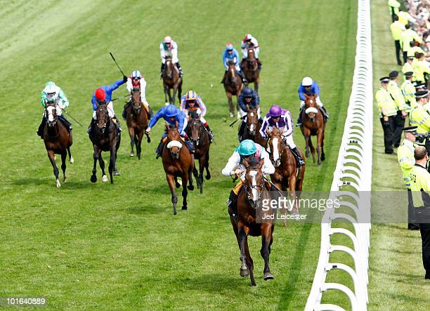 Ryan Moore riding Workforce wins the Investec Derby race by a long way during the Investec Derby Festival at Epsom racecourse on June 5 2010 in Epsom...