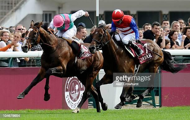 Ryan Moore riding Workforce wins The Qatar Prix de l'arc de Triomphe from Nakayama Festa at the Hippodrome de Longchamp on October 03 2010 in Paris...