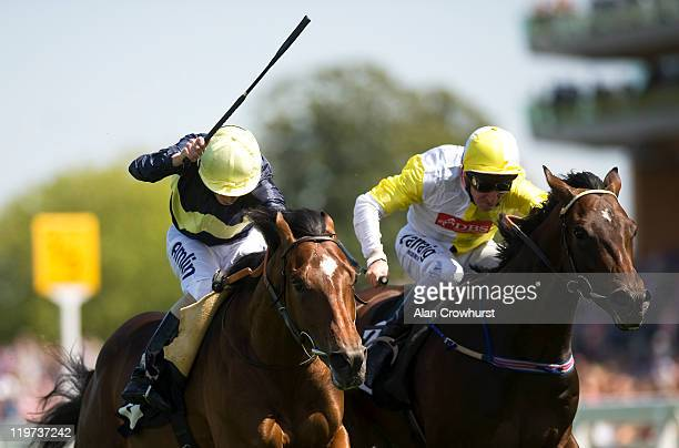 Ryan Moore riding Zumbi go on to win The Anders Foundation EBF Crocker Bulteel Maiden Stakes from Glen Moss and Michael Hills at Ascot racecourse on...