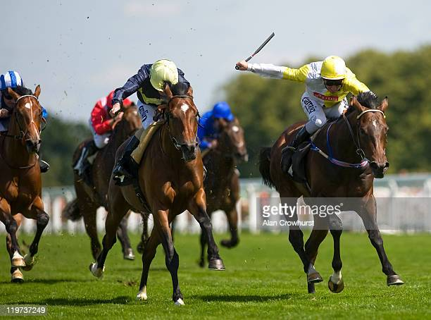 Ryan Moore riding Zumbi goes on to win The Anders Foundation EBF Crocker Bulteel Maiden Stakes from Glen Moss and Michael Hills at Ascot racecourse...