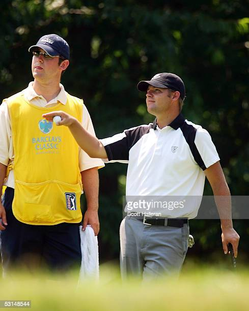 Ryan Moore talks with his caddie Kirk Brown on the tenth green during the third round of the Barclays Classic on June 25 2005 at Westchester Country...
