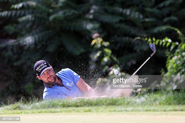 Ryan Moore, USA, plays out of a bunker during the final round of the Travelers Championship at the TPC River Highlands, Cromwell, Connecticut, USA....