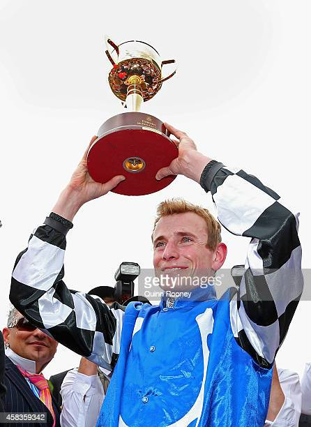 Ryan Moore who rode Protectionist to win the Emirates Melbourne Cup raises the trophy on Melbourne Cup Day at Flemington Racecourse on November 4...