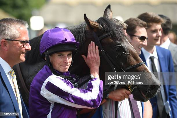 Ryan Moore with US Navy Flag after winning the Darley July Cup Stakes during day three of The Moet Chandon July Festival at Newmarket Racecourse