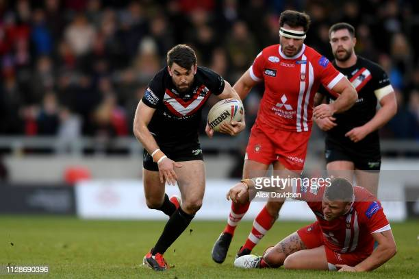 Ryan Morgan of London Broncos breaks past Josh Jones Salford Red Devils of during the Betfred Super League match between Salford Red Devils and...