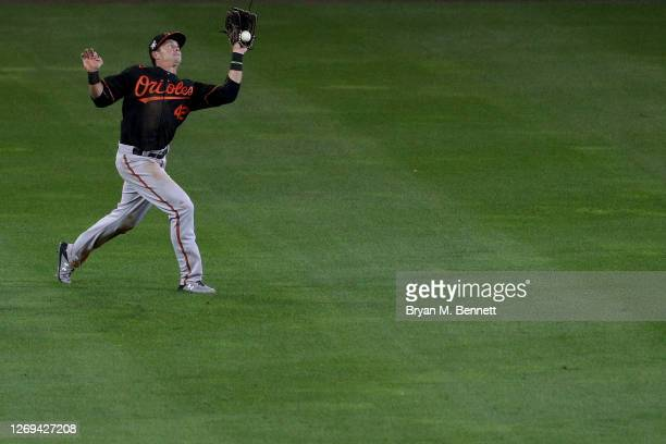 Ryan Mountcastle of the Baltimore Orioles catches a flyball hit by Travis Shaw of the Toronto Blue Jays during the ninth inning at Sahlen Field on...