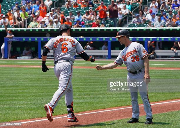 Ryan Mountcastle of the Baltimore Orioles hits a home run and celebrates with Tony Mansolino during the first inning against the Toronto Blue Jays at...