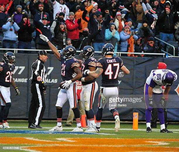 Ryan Mundy of the Chicago Bears celebrates his interception against the Minnesota Vikings during the fourth quarter on November 16 2014 at Soldier...