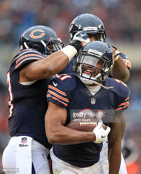 Ryan Mundy of the Chicago Bears celebrates his interception on the 2yard line with Jon Bostic and Christian Jones during the second quarter of their...