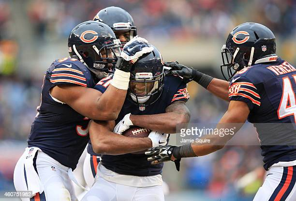 Ryan Mundy of the Chicago Bears celebrates his interception with Jon Bostic Christian Jones and Brock Vereen of the Chicago Bears during the second...