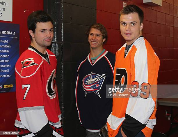 Ryan Murphy of the Carolina Hurricanes Ryan Murray of the Columbus Blue Jackets and Scott Laughton of the Philadelphia Flyers meet with the media at...