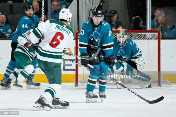 Ryan Murphy of the Minnesota Wild fires the puck by Marcus Sorensen as Aaron Dell of the San Jose Sharks protects the net at SAP Center on April 7...