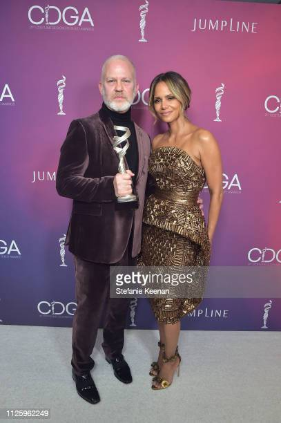 Ryan Murphy recipient of the Distinguished Collaborator Award and Halle Berry attend The 21st CDGA at The Beverly Hilton Hotel on February 19 2019 in...
