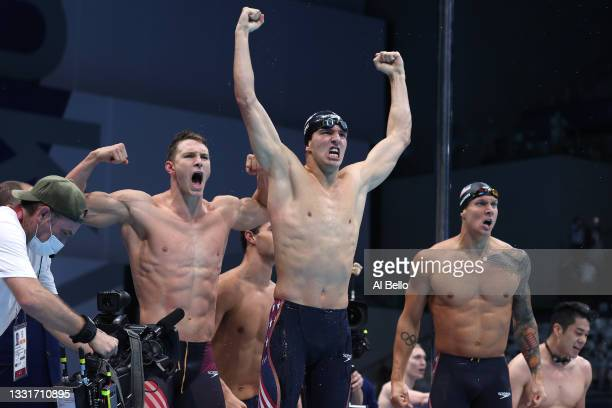 Ryan Murphy, Zach Apple and Caeleb Dressel of Team United States react after winning the gold medal and breaking the world record in the Men's 4 x...