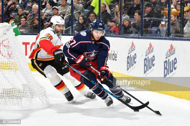 Ryan Murray of the Columbus Blue Jackets attempts to keep the puck from Jaromir Jagr of the Calgary Flames during the second period of a game on...